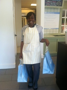 Smiling worker providing customer service at Mulberrys. Get your e-pickup deal!