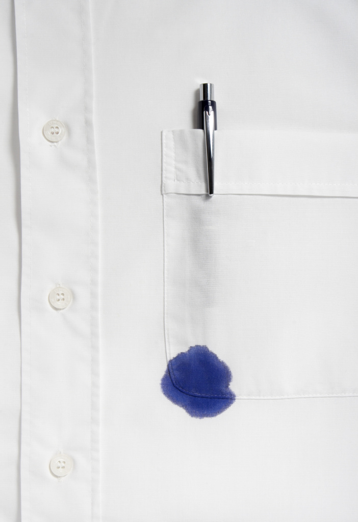 close up of businessman ruined shirt and and leaking pen